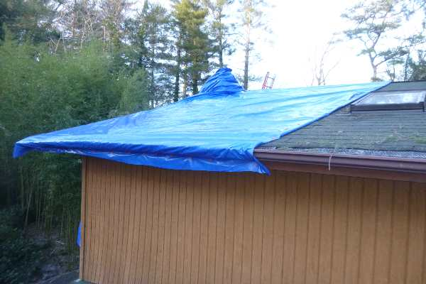 storm roof damage tarping
